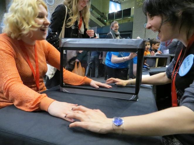A mirror box experiment at a Barbican 'Wonder' event.