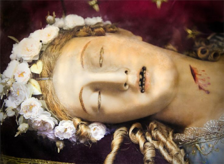 Head of Saint Vittoria, crafted of wax, hair and what looks like human teeth, church of Santa Maria della Vittoria, Rome, Italy. Photo by Joanna Ebenstein, Morbid Anatomy