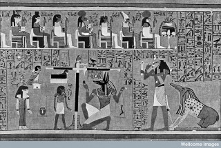 Weighing of the heart by Osiris, god of the Egyptian Underworld.