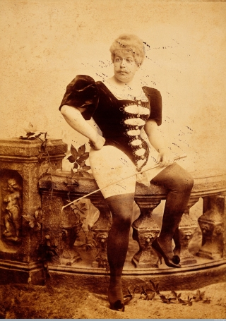 L0031641 PP/KEB/E/6/1, Man seated, wearing corset and holding whip