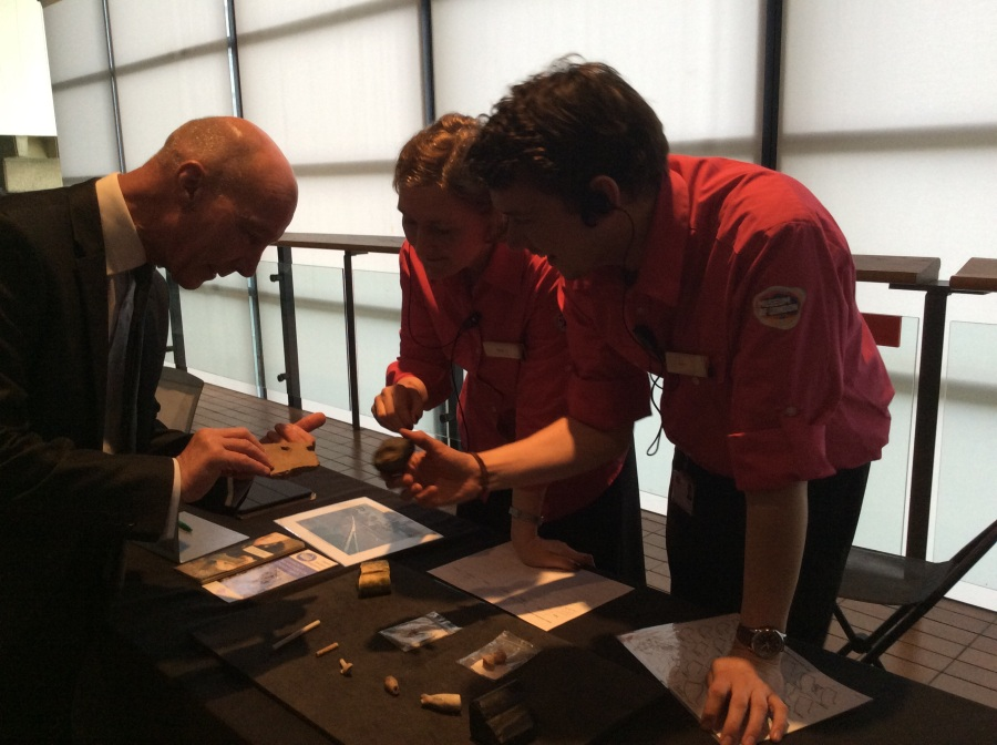 Visitor Hosts using the handling collection for public engagement at the Museum of London.