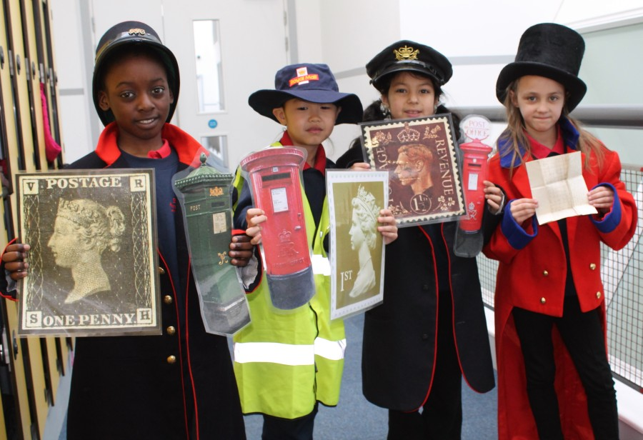 School group using the British Postal Museum and Archive handling collection. (©The British Postal Museum & Archive)