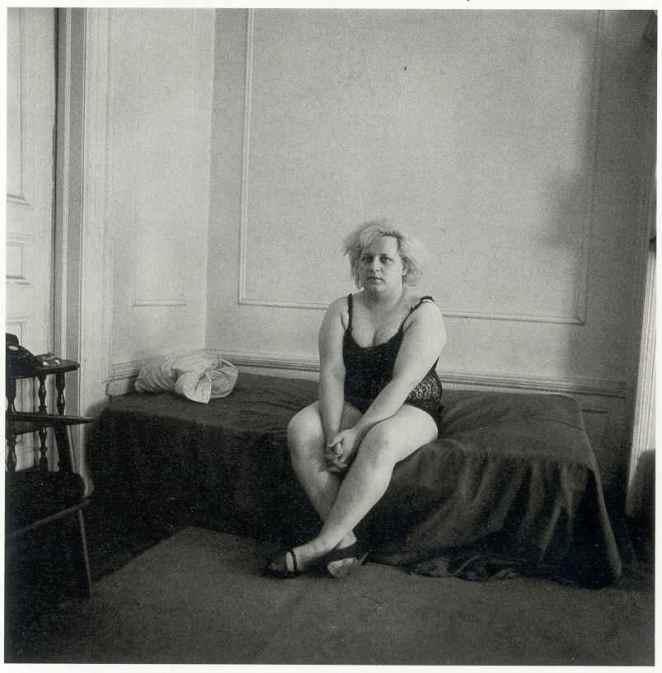 """Diane Arbus, """"Seated transvestite with crossed ankles, N.Y.C., 1966"""", 1966."""