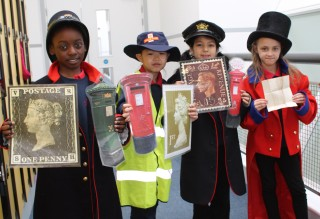 School group using the British Postal Museum and Archive handling collection. (© The British Postal Museum & Archive)