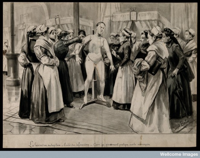 V0015256 Nurses being lectured on bandaging using a mannequin on a ho