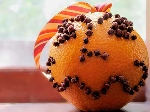 Pomanders started to appear at Christmas in the 18th century in the form of an orange studded with cloves and other spices.