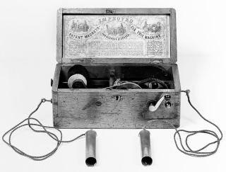 The Magneto-electric Machine was very popular for nervous diseases. It was an induction machine in which current was created by turning the handle. As the drawings in the lid show, the patient then held the handles to complete the circuit. circa 1855
